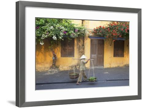 Woman Carrying Vegetables in Street, Hoi An, Quang Nam, Vietnam, Indochina, Southeast Asia, Asia-Ian Trower-Framed Art Print