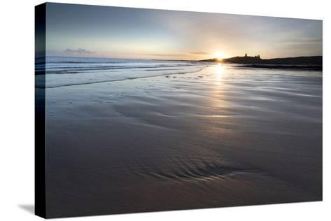 View over Embleton Beach at Sunrise Towards the Silhouetted Ruin of Dunstanburgh Castle-Lee Frost-Stretched Canvas Print