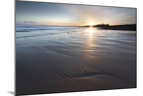 View over Embleton Beach at Sunrise Towards the Silhouetted Ruin of Dunstanburgh Castle-Lee Frost-Mounted Photographic Print