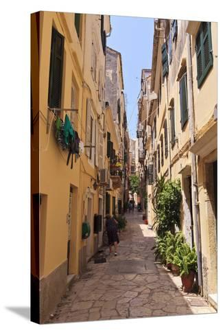 Narrow Street with Lady Sweeping, Old Town, Corfu Town-Eleanor Scriven-Stretched Canvas Print