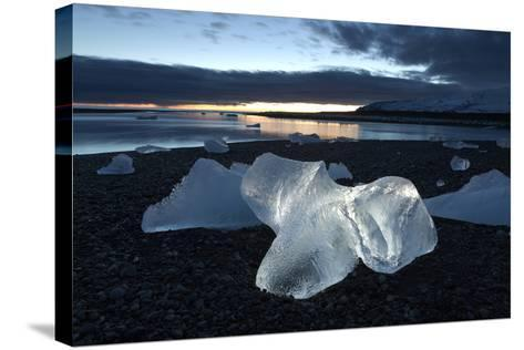Icebergs at Sunset on Jokulsa Beach, on the Edge of the Vatnajokull National Park, South Iceland-Lee Frost-Stretched Canvas Print