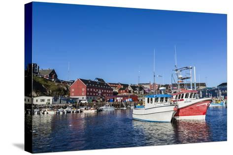 Commercial Fishing and Whaling Boats Line the Busy Inner Harbor in the Town of Ilulissat-Michael Nolan-Stretched Canvas Print