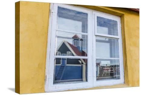 Church Reflected in Brightly Painted House Window in Sisimiut, Greenland, Polar Regions-Michael Nolan-Stretched Canvas Print