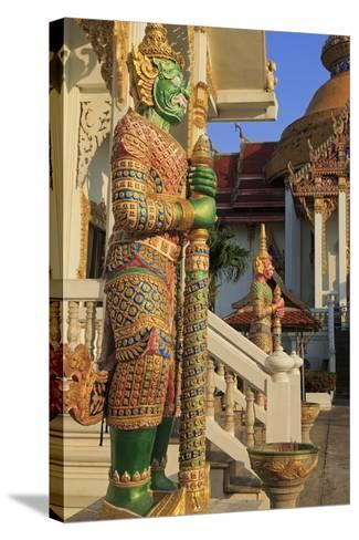 Warrior in Wat Chamongkron Royal Monastery, Pattaya City, Thailand, Southeast Asia, Asia-Richard Cummins-Stretched Canvas Print