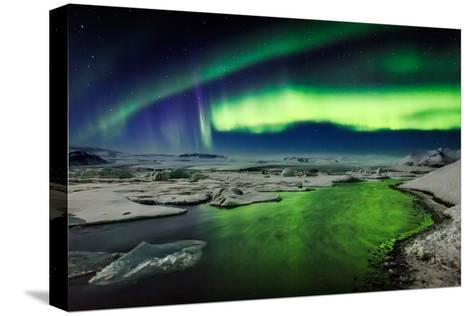 Auroras and Icebergs at the Glacial Lagoon, Jokulsarlon, Breidamerkurjokull, Vatnajokull Ice Cap--Stretched Canvas Print