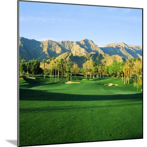 Trees in a Golf Course with a Mountain Range in the Background, Thunderbird Country Club--Mounted Photographic Print