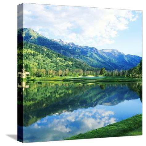 Reflection of Clouds on Water, Teton Pines Golf Course, Jackson, Wyoming, USA--Stretched Canvas Print