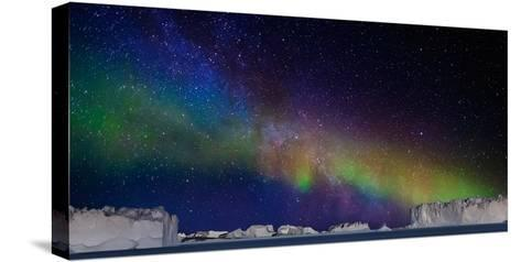 Digital Composite - Aurora Borealis or Northern Lights in Iceland and Icebergs in Greenland--Stretched Canvas Print