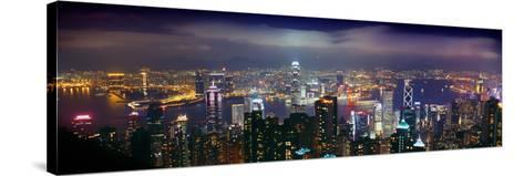 Aerial View of a City Lit Up at Night, Hong Kong, China--Stretched Canvas Print