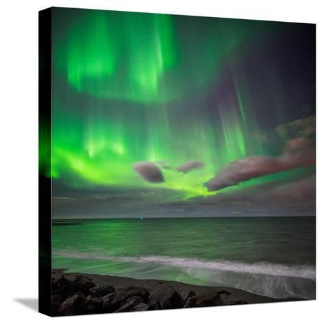 Northern Lights over the Waves Breakiing on the Beach in Seltjarnarnes, Reykjavik, Iceland--Stretched Canvas Print