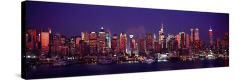 Buildings Lit Up at Dusk, Manhattan, New York City, New York State, USA--Stretched Canvas Print