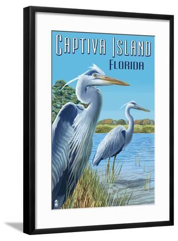 Captiva Island, Florida - Blue Herons in grass-Lantern Press-Framed Art Print