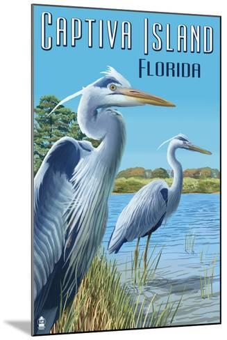 Captiva Island, Florida - Blue Herons in grass-Lantern Press-Mounted Art Print