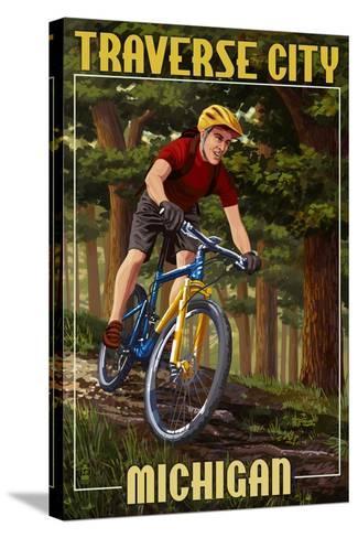 Traverse City, Michigan - Mountain Biker in Trees-Lantern Press-Stretched Canvas Print