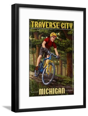 Traverse City, Michigan - Mountain Biker in Trees-Lantern Press-Framed Art Print