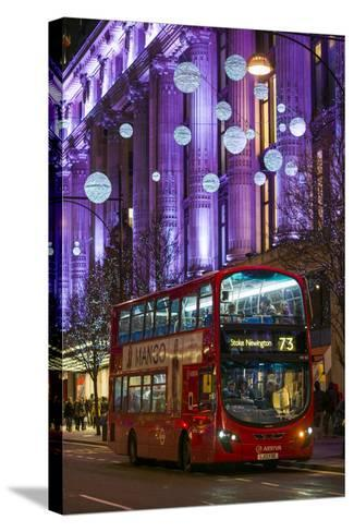 England, London, Soho, Oxford Street, Chirstmas Decorations and London Bus-Walter Bibikow-Stretched Canvas Print