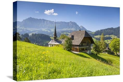 Church and Farmhouse in a Village in the Emmental Valley, Berner Oberland, Switzerland-Jon Arnold-Stretched Canvas Print
