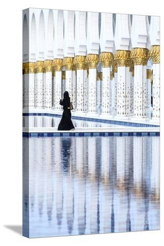 United Arab Emirates, Abu Dhabi. Arabic Woman Walking Inside Sheikh Zayed Grand Mosque-Matteo Colombo-Stretched Canvas Print