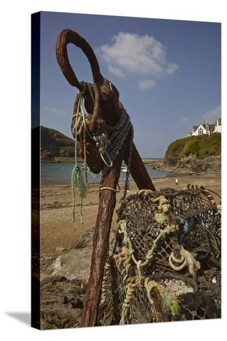 An Old Anchor Next to Crab Pots Piled Up Beside the Harbor in Port Isaac, Near Padstow, Cornwall-Nigel Hicks-Stretched Canvas Print