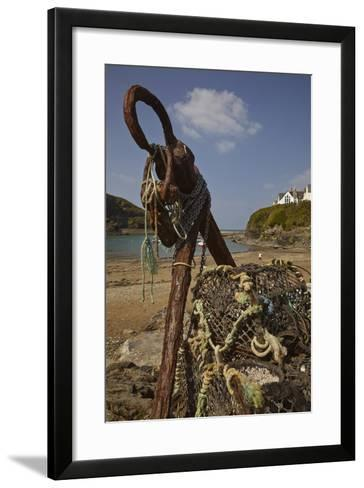 An Old Anchor Next to Crab Pots Piled Up Beside the Harbor in Port Isaac, Near Padstow, Cornwall-Nigel Hicks-Framed Art Print