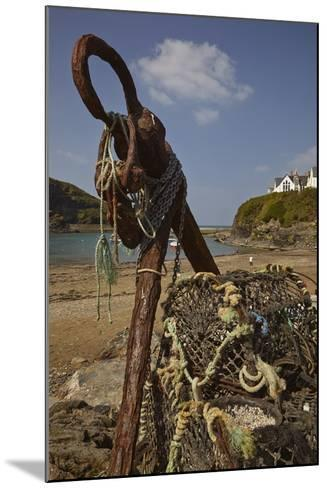 An Old Anchor Next to Crab Pots Piled Up Beside the Harbor in Port Isaac, Near Padstow, Cornwall-Nigel Hicks-Mounted Photographic Print