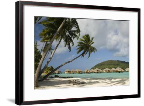 Over-The-Water Bungalows at a Tropical Resort with Clear Turquoise Water and Wind-Blown Palms-Sergio Pitamitz-Framed Art Print