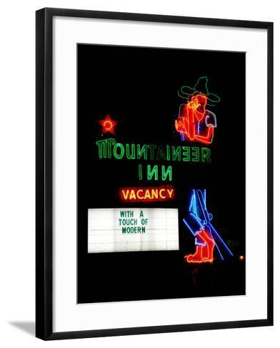 A Stereotypical Mountain Man Graces the Neon Sign of a Local Landmark-Amy and Al White and Petteway-Framed Art Print