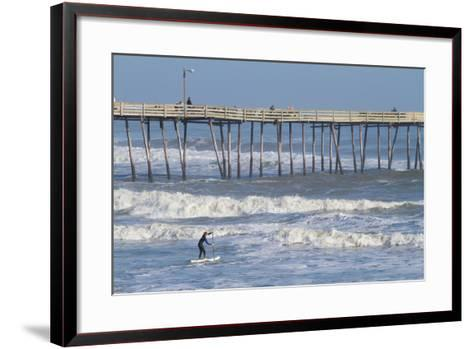 A Boy Paddles Out into Big Waves on His Standup Paddle Board Next to Nags Head Pier-Skip Brown-Framed Art Print