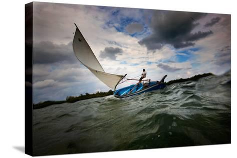 A Man Sails a Boat Off the Cayman Islands in the Caribbean-Chris Bickford-Stretched Canvas Print