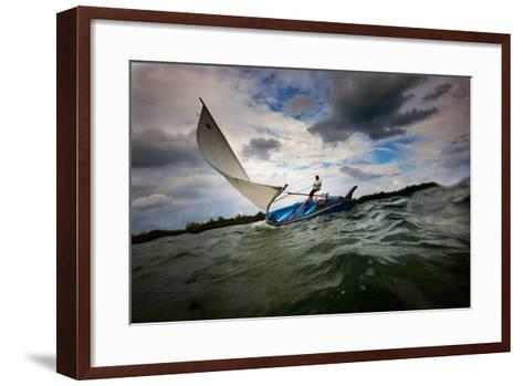 A Man Sails a Boat Off the Cayman Islands in the Caribbean-Chris Bickford-Framed Art Print