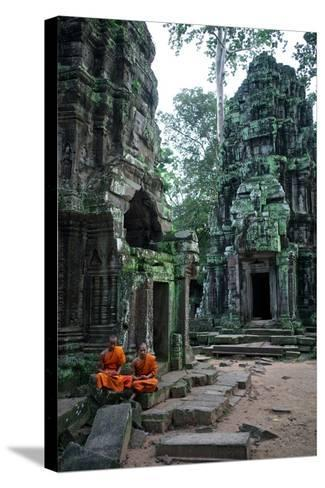 Theraveda Buddhist Monks at the Ta Prohm Temple in the Angkor Complex-Kike Calvo-Stretched Canvas Print