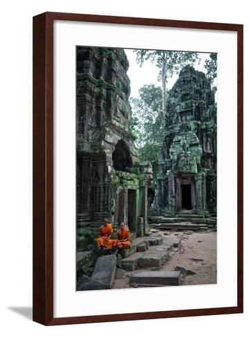 Theraveda Buddhist Monks at the Ta Prohm Temple in the Angkor Complex-Kike Calvo-Framed Art Print