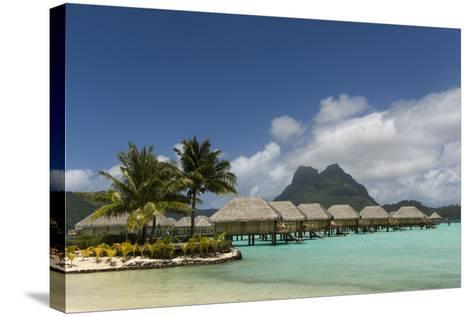 Over-The-Water Bungalows at a Tropical Resort with Clear Turquoise Water-Sergio Pitamitz-Stretched Canvas Print