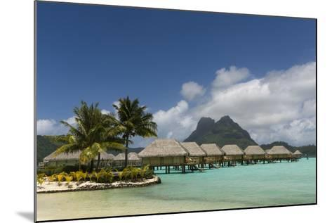 Over-The-Water Bungalows at a Tropical Resort with Clear Turquoise Water-Sergio Pitamitz-Mounted Photographic Print