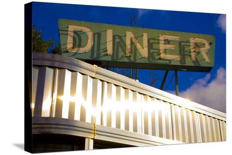 An Old Neon Diner Sign Above Glistening Reflective Aluminum Siding-Stephen St^ John-Stretched Canvas Print