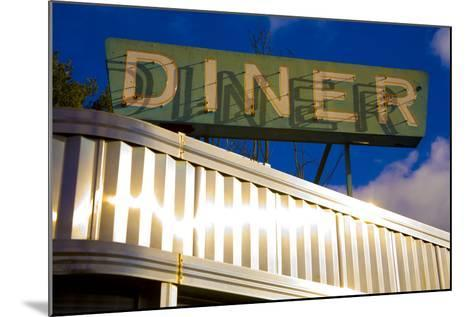 An Old Neon Diner Sign Above Glistening Reflective Aluminum Siding-Stephen St^ John-Mounted Photographic Print