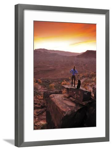 A Woman and a Dog on Top of a Rock Covered in Petroglyphs, Looking at a Beautiful Sunset-Keith Ladzinski-Framed Art Print