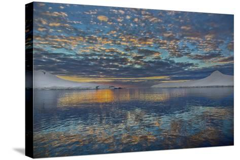 A Beautiful Seascape of Puffy Little Clouds Reflected in Icy Water at Sunset-Ira Meyer-Stretched Canvas Print