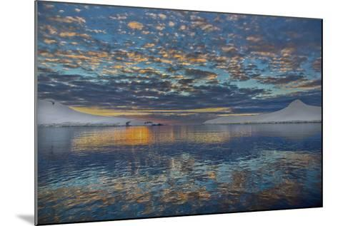 A Beautiful Seascape of Puffy Little Clouds Reflected in Icy Water at Sunset-Ira Meyer-Mounted Photographic Print