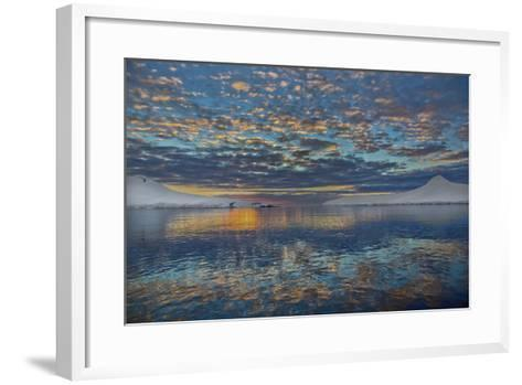 A Beautiful Seascape of Puffy Little Clouds Reflected in Icy Water at Sunset-Ira Meyer-Framed Art Print