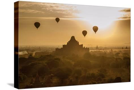 Balloons Above Stupas and Dhammayangyi Patho Temple from the Shwesandaw Pagoda-Tino Soriano-Stretched Canvas Print