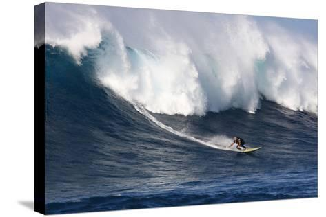 Garrett Mcnamara, Big Wave Surfer, Surfing Down a Wave Face at Jaws-Patrick McFeeley-Stretched Canvas Print