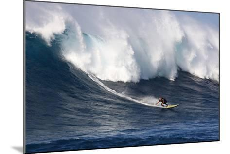 Garrett Mcnamara, Big Wave Surfer, Surfing Down a Wave Face at Jaws-Patrick McFeeley-Mounted Photographic Print