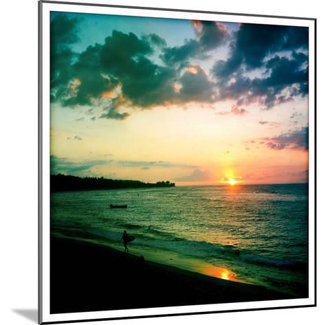 A Surfer Heading Home at Sunset on Shacks Beach Near Aquadilla, Puerto Rico-Skip Brown-Mounted Photographic Print