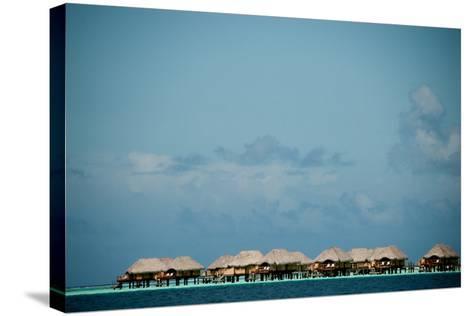 Vacation Cottages over Water on Bora Bora-Karen Kasmauski-Stretched Canvas Print