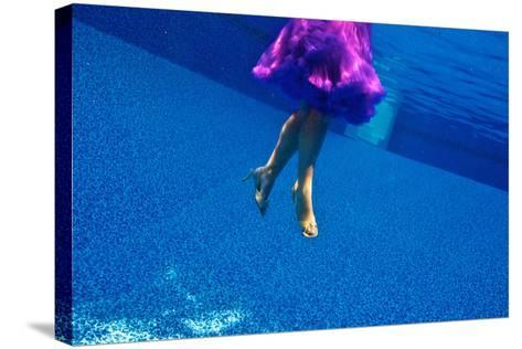 A Model Floats in a Pool, Wearing a Skirt and Heels-Heather Perry-Stretched Canvas Print