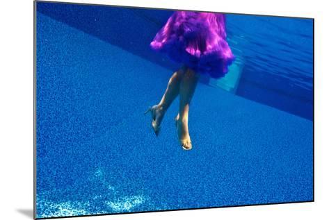 A Model Floats in a Pool, Wearing a Skirt and Heels-Heather Perry-Mounted Photographic Print