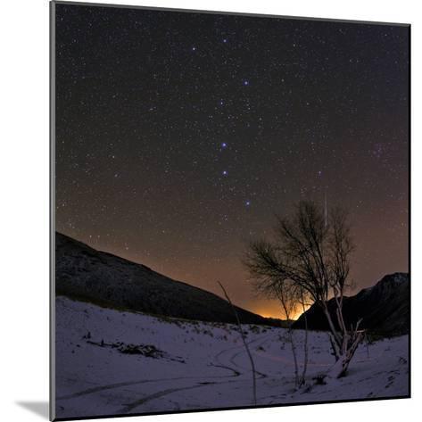 A Bright Meteor Streaks the Sky Near the Big Dipper-Babak Tafreshi-Mounted Photographic Print