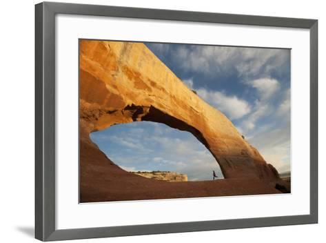 A Young Girl Running in a Sandstone Arch-Peter Mather-Framed Art Print