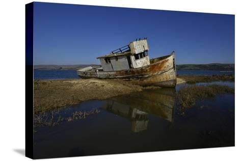 The Wreck of a Fishing Boat-Raul Touzon-Stretched Canvas Print